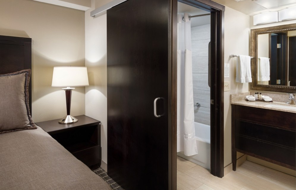 View into the bathroom area with vanity and separate area than shower